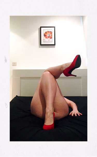A photo of my magic shoes - shown off as I lie naked on my bed
