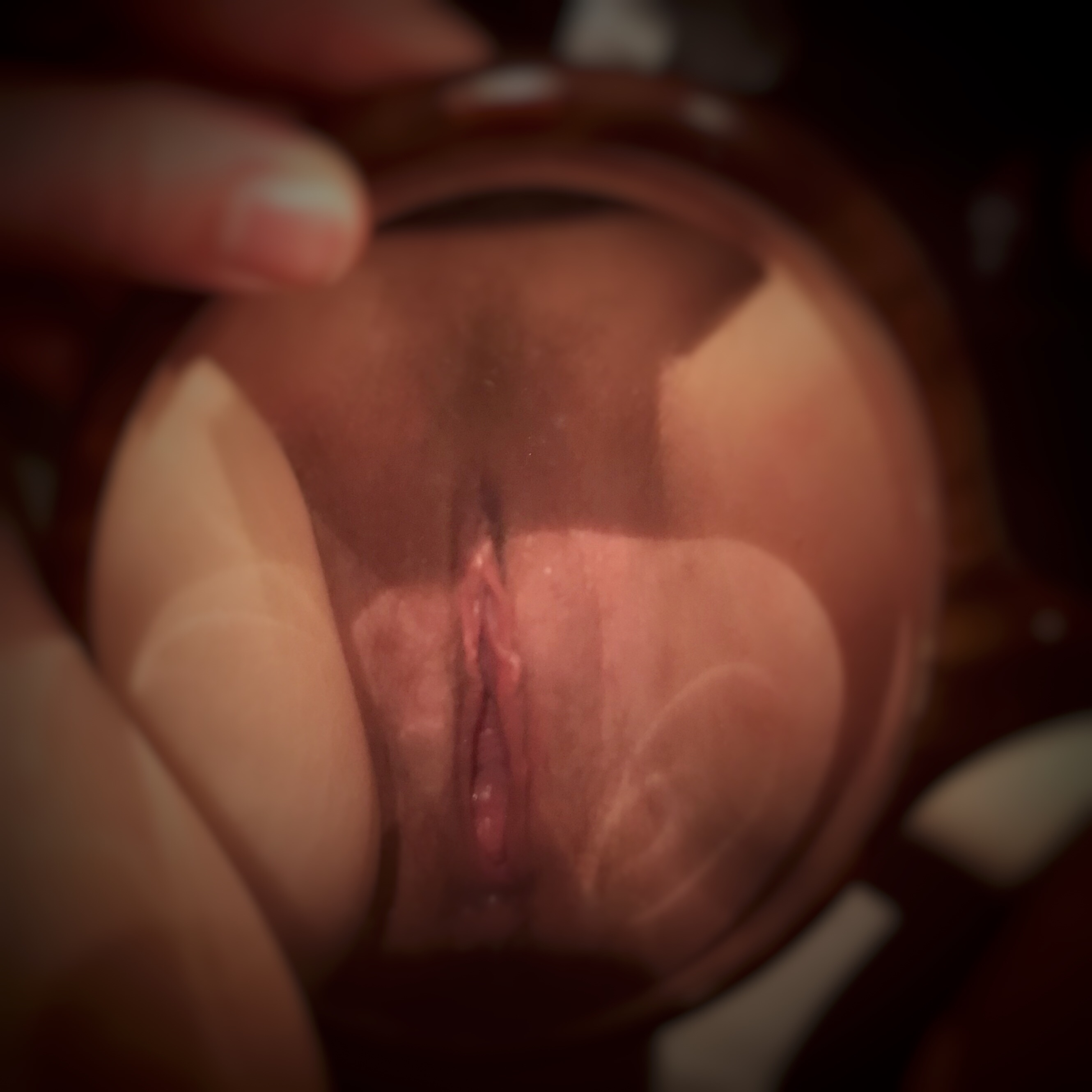 A photo of a mirror held between my thighs, showing a reflection of my vulva