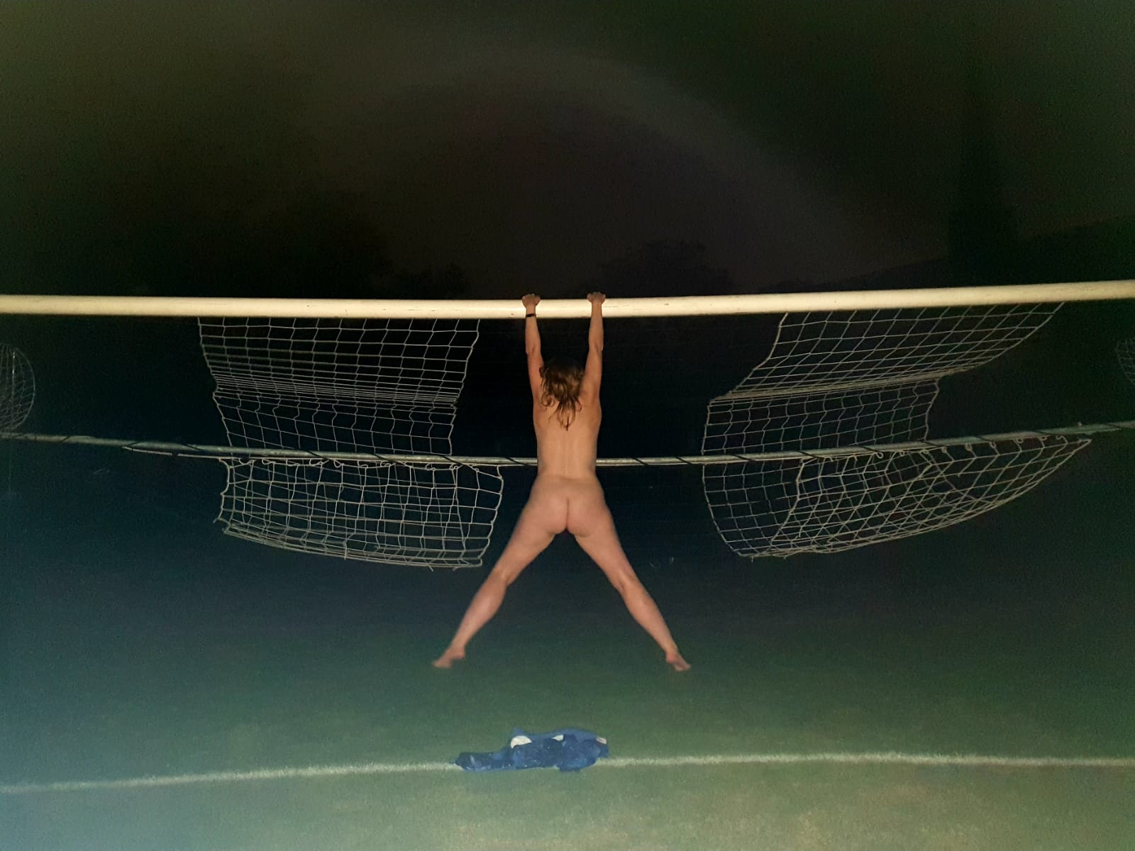 Naked me hanging off the crossbar of a football goal