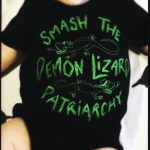 My baby wearing a vest that says 'Smash the Demon Lizard Patriarchy!' - an example of activist baby clothes!