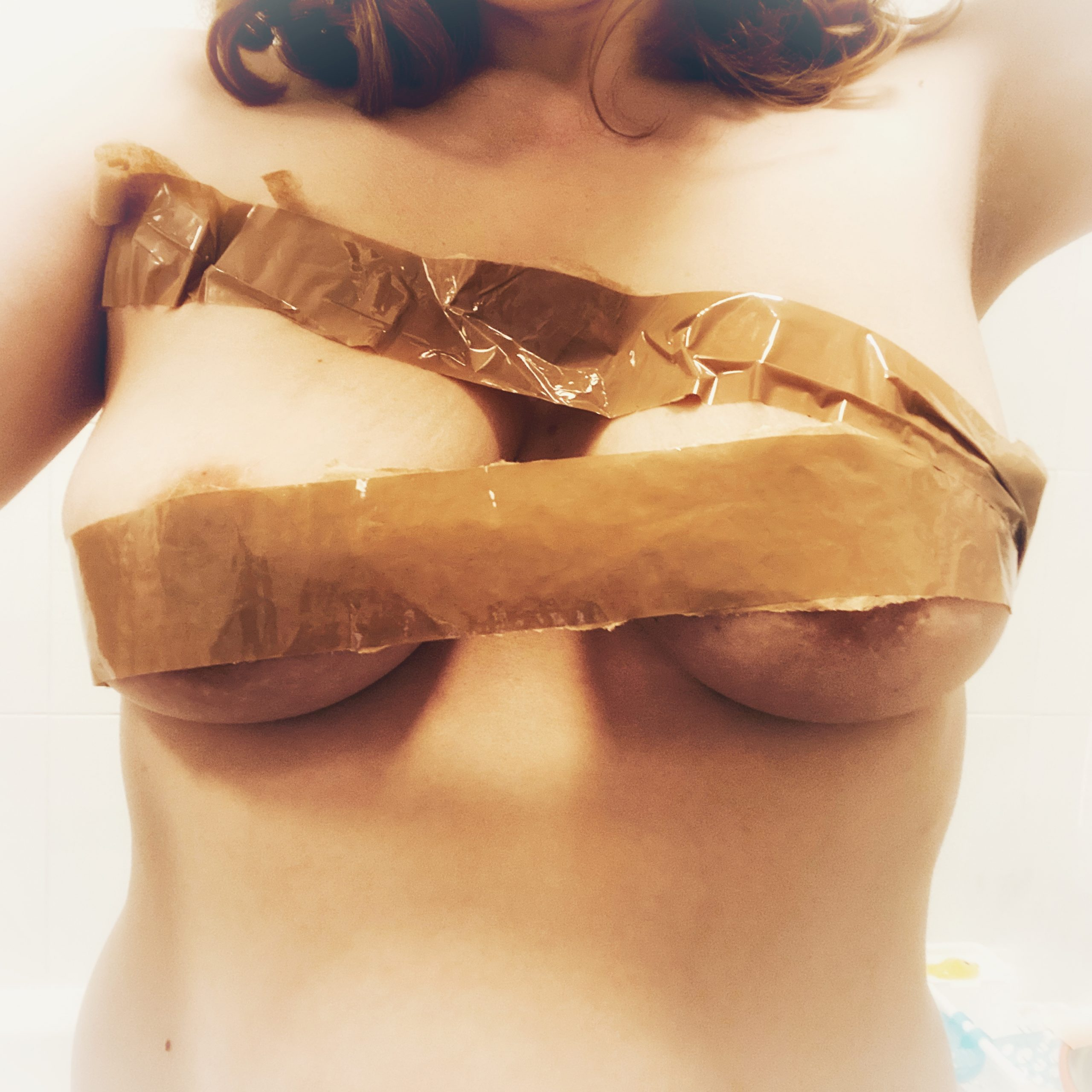 My naked breasts wrapped in parcel tape