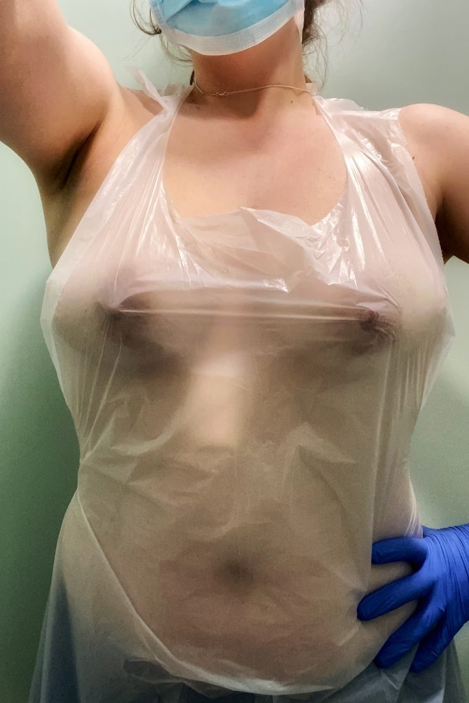 A photo of me, naked except for surgical gloves, plastic apron and surgical mask - all the PPE offered to me