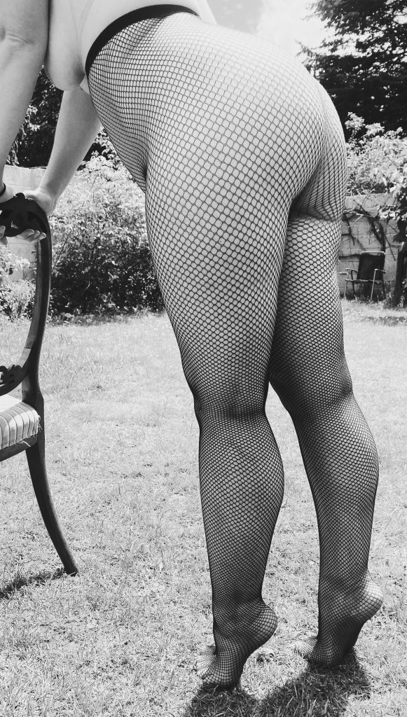 Me, wearing fishnets only and bending over a chair like the Smutathon logo, ready for launch next Friday!
